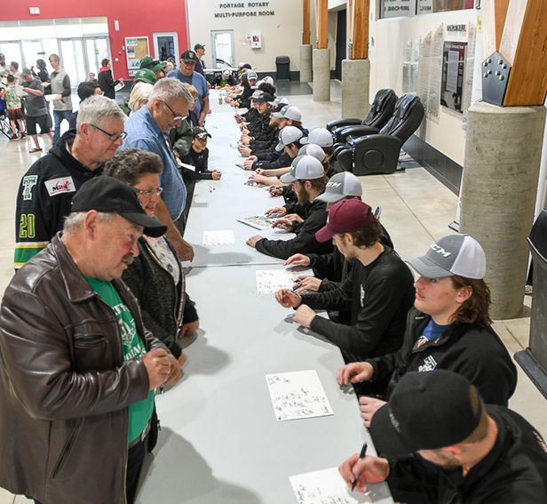 Portage Terriers sign autographs at May 7 pep rally