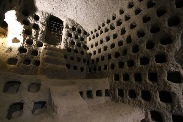 In medieval times, the people of Orvieto farmed pigeons. The holes in the volcanic tuff are nests