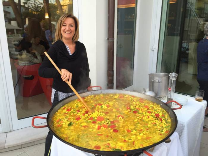 Marina mixes up a giant batch of paella