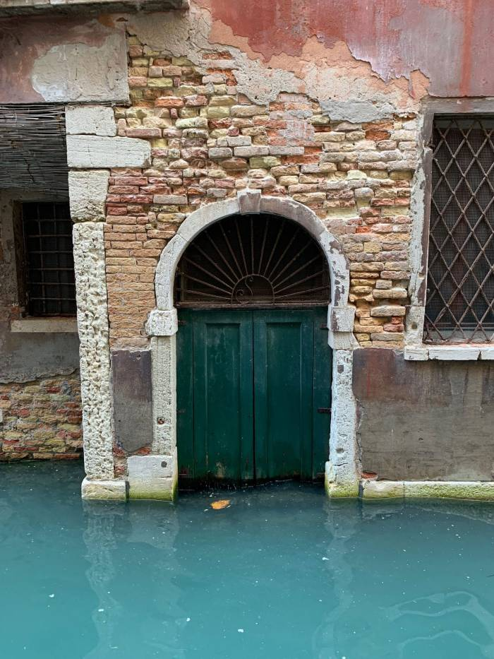 Evidence of past floods in a narrow Venetian canal. Photo by Mike Robinson